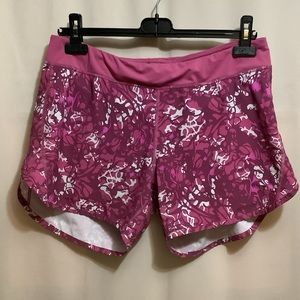 Patagonia pink patterned running shorts with built in underwear and back pockets